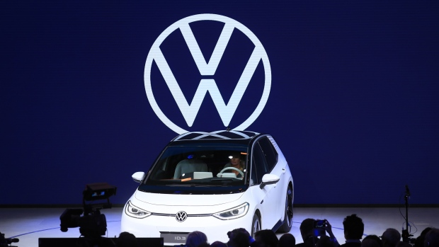 attendees-inspect-a-volkswagen-ag-vw-id-3-electric-automobiles-during-a-preview-event-ahead-of-its-world-premiere-at-the-vw-group-night-ahead-at-the-iaa-frankfurt-motor-show-in-frankfurt-germany-on-monday-sept-9-2019-the-.jpg